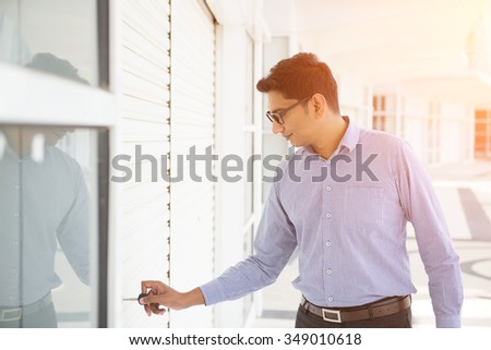 indian male opening shop - stock photo