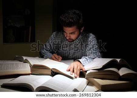 Indian male student doing exams preparation. - stock photo