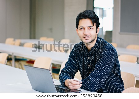 Indian male student with laptop