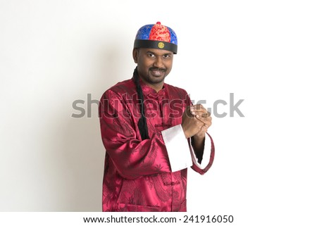 indian male with chinese new year clothes  - stock photo