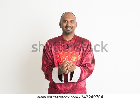 indian male with chinese new year clothes and ang pao - stock photo