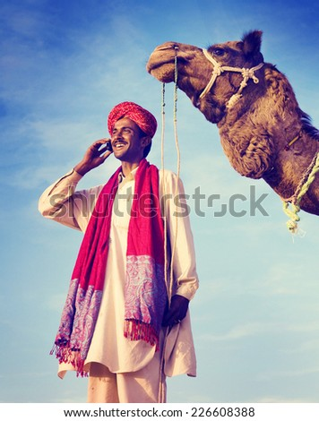 Indian Man On the Phone Camel Communication Concept - stock photo