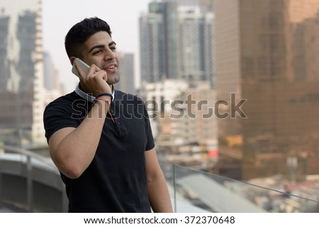 Indian man talking on phone