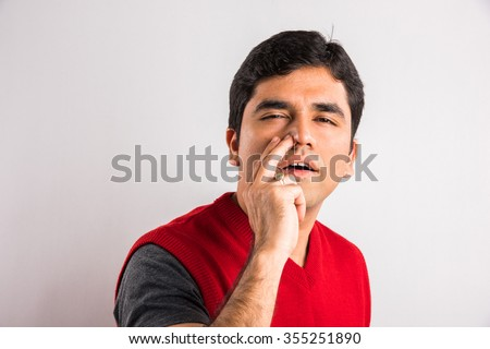 indian man with choked nostril, choked nose, indian man having congestion in nostril  - stock photo