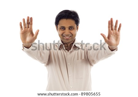 Indian man with his hands raised in signal to stop - stock photo