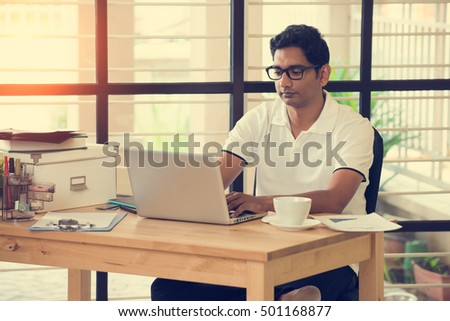 indian man working at office