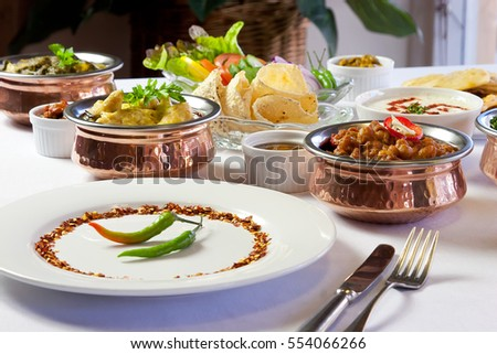Indian meal on setting on table & Indian Meal On Setting On Table Stock Photo 554066266 - Shutterstock