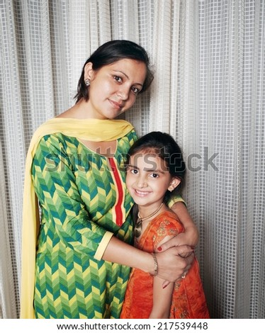 Indian mother loving her kid. - stock photo