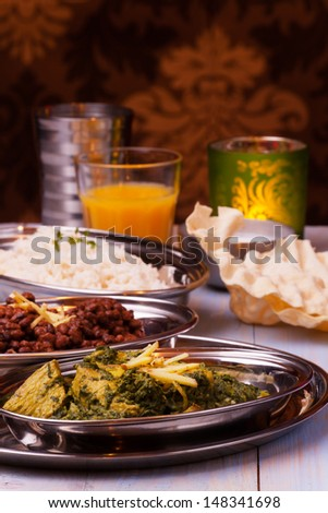 indian murgh palak and dhal with rice  - stock photo