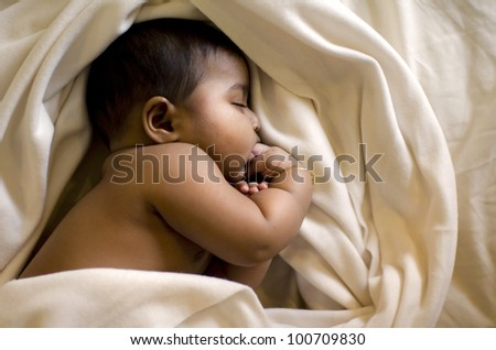 indian muslim baby sleeping - stock photo
