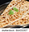 Indian naan bread with coriander - stock photo