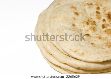 Indian nan bread stack isolated on white, shawarma wrap