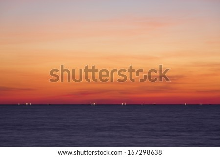 Indian Ocean at dusk seen from Ngapali Beach near Thandwe, Rakhine State, Myanmar, Southeast Asia. 10 seconds exposure time. - stock photo
