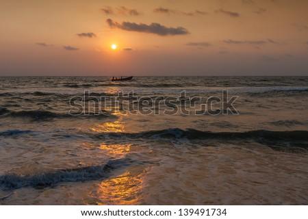 Indian Ocean at sunset. Varkala. Kerala. India - stock photo
