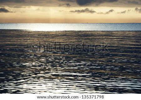 Indian Ocean in the glow of the setting sun 01 - stock photo