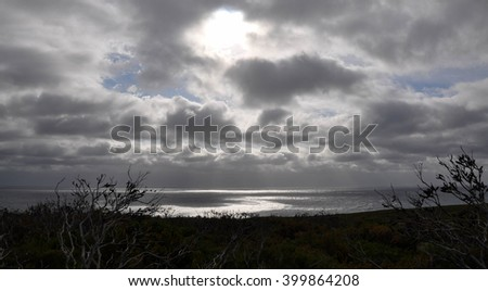 Indian Ocean seascape and coastal dunes during at storm at Cape Leeuwin in Dunsborough, Western Australia/Stormy Seascape at Cape Leeuwin/Dunsborough, Western Australia - stock photo