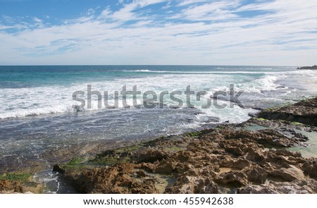 Indian Ocean seascape with small inlet and limestone rock at Penguin Island in Rockingham, Western Australia/Limestone Inlet at Penguin Island/Rockingham, Western Australia - stock photo