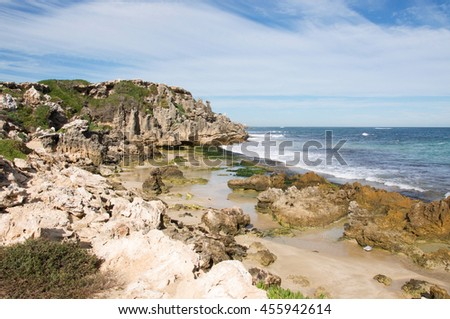Indian Ocean waters and limestone cliffs at Penguin Island in Rockingham, Western Australia/Rugged Limestone Bluffs/Penguin Island, Rockingham, Western Australia - stock photo