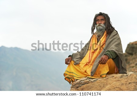 external image stock-photo-indian-old-monk-sadhu-in-saffron-color-clothing-110741174.jpg