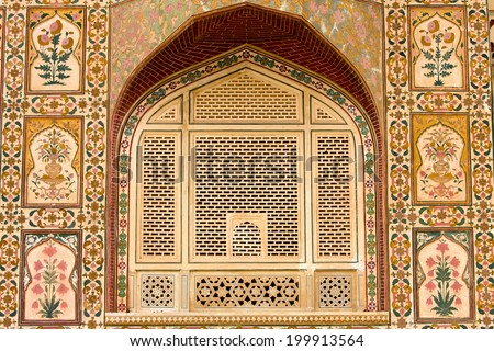 Indian ornament on wall of palace in Jaipur fort India - stock photo