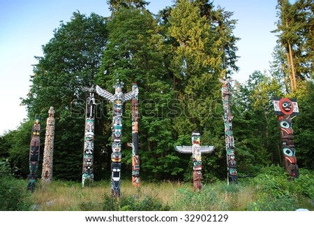 Indian painted totem poles in Stanley Park, Vancouver Canada - stock photo