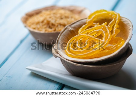 Indian popular sweet - jalebi, with spicy sev (fried noodles) - stock photo