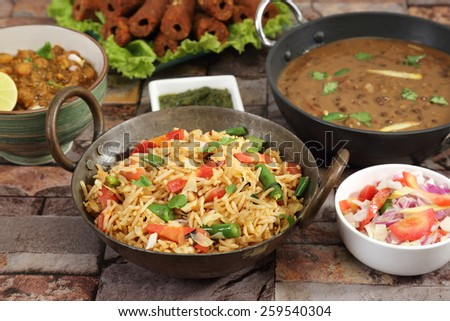 Indian Pulav or Vegetable Pulao with Chana Masala and Dal Makhani - stock photo