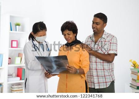 indian punjabi family senior doctor appointment medical checkup - stock photo