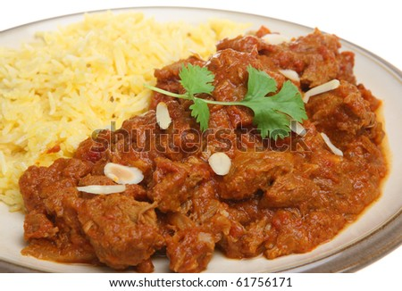 Indian Rogan Josh lamb curry with pilau rice. - stock photo