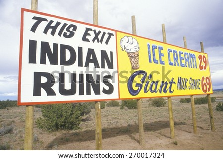 Indian Ruins billboard next to Ice Cream and Milkshake advertisement in NM