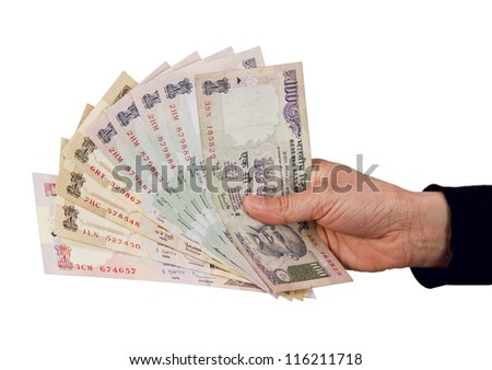 Indian rupee notes in hand - stock photo