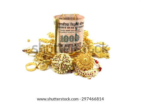Indian Rupee or Money and Gold Jewelry  - stock photo