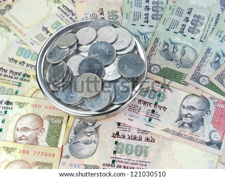 Indian rupees and coins of different denominations. - stock photo