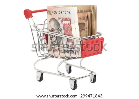 Indian 1000 rupees in shopping cart isolated on white background