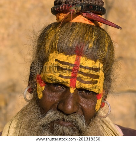 Indian sadhu , holy man.  Jaisalmer, Rajasthan, India. - stock photo
