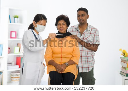 indian senior citizen health check with a chinese female doctor at hospital