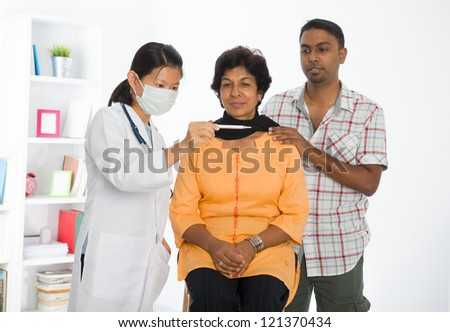 indian senior doctor appointment medical checkup - stock photo