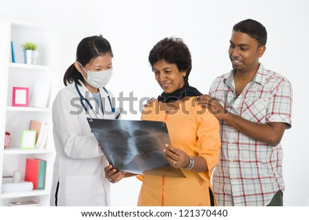indian senior medical checkup with an asian female doctor - stock photo