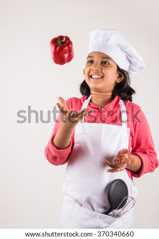 indian small girl chef - stock photo