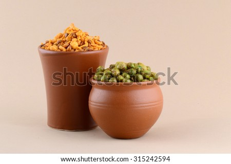 Indian snack: Mixture and Spiced fried green peas {chatpata matar} in clay pots.  - stock photo