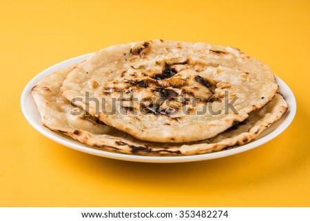 indian special bread also known as butter roti, chapati, naan, kulcha, paratha, tanduri roti - stock photo