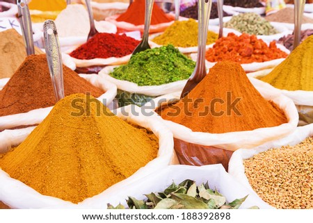 Indian spices in bags at traditional street market - stock photo