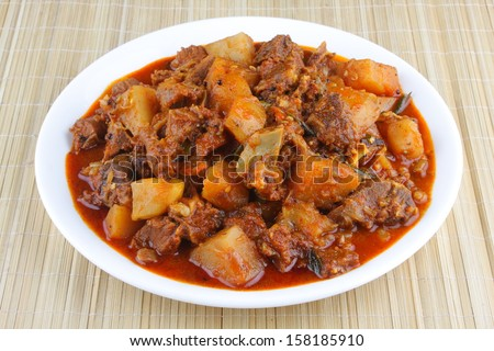 Indian spicy meat curry with potatos.