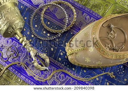 Indian still life with belly dance shoe and jewelry - stock photo