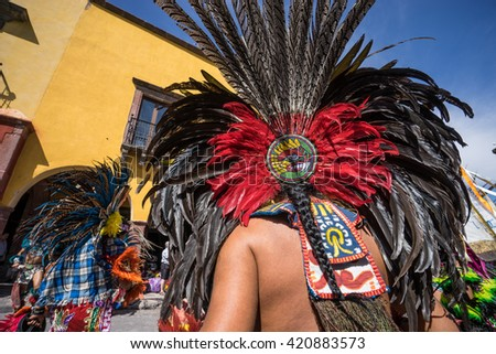 indian street dancer in Mexico wearing traditional feather headdress