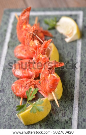 indian tandoori prawn spiced up with herbs and then grilled in tandoor