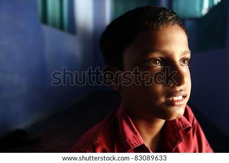 Indian teen boy posing to the camera. - stock photo