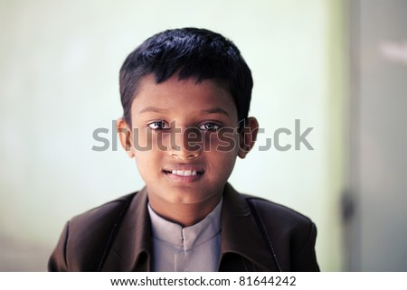 Indian teen boy smiling. - stock photo