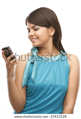 indian teenage girl with cell phone - stock photo