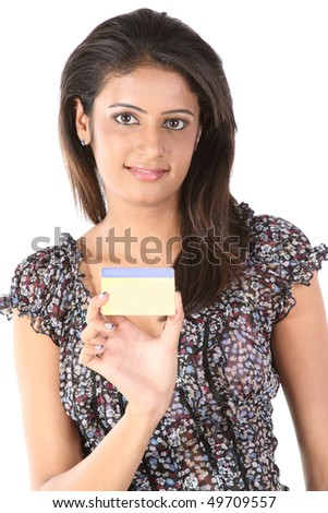 Indian teenage girl with credit card - stock photo